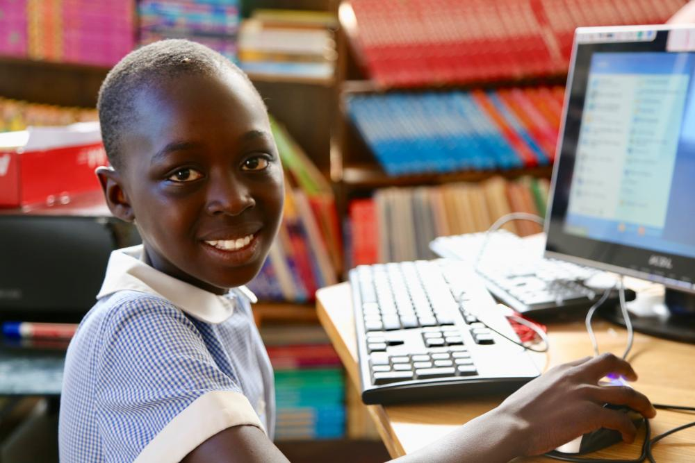 Students use laptops to learn in Rwanda
